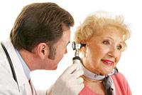 doctor examining ear